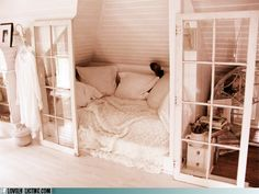 Built in bed nook....what a great little reading space!