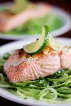 This recipe for coconut lime salmon is great for a weeknight meal. It's low carb/keto, paleo, and low calorie! You can serve these salmon fillets with any sides you'd like! My favorite way is over cucumber noodles, as pictured here! So easy and delicious. Make this for a healthy lunch or dinner!