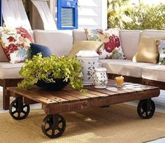Pallet coffee table.I love the wheels on this one... I am thinking two put together length wise and longer legs...could be a kitchen table size