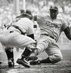 Jackie Robinson steals home against Yogi Berra and the New York Yankees in the World Series opener at Yankee Stadium (Sept. 28, 1955) • Photo: Mark Kauffman / Sports Illustrated on Getty Images