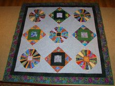 Quilt with fabrics I had fun with.