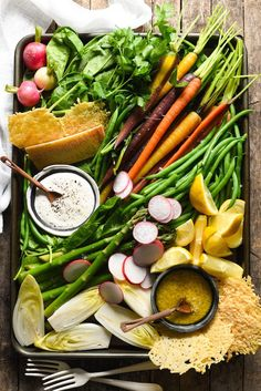 **PERFECT FOR MOTHER'S DAY BRUNCH** DIY Spring Salad Board - Assemble a bounty of spring produce on a platter, along with creamy Parmesan-Peppercorn Dressing, tangy Parmesan Vinaigrette, and crunchy Parmesan Fricos, and let your guests assemble their own salad with this fun party idea! | foxeslovelemons.com
