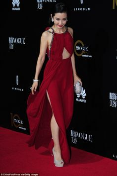Beauty: Li walked the red carpet with effortless panache, flaunting her leg and enviable glitzy platform heels in the process