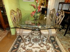 Keep it light and airy with this metal and glass top dining table and four (4) chairs. Measures 61 x 37 x 30. Arrived: Thursday October 6th, 2016