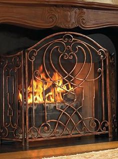 Enhance your hearth this winter with the Tierney Fire Screen that features  intricate patterns sure to draw attention and heavy-gauge mesh to protect your home and guests from errant sparks and flames.