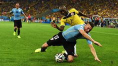 Jose Gimenez of Uruguay is challenged by Pablo Armero of Colombia during the 2014 FIFA World Cup Brazil round of 16 match between Colombia and Uruguay at Maracana on June 28, 2014 in Rio de Janeiro, Brazil. (Photo by Matthias Hangst/Getty Images)