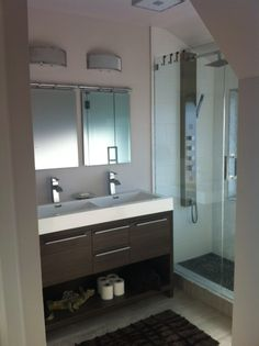 Walk in Shower & Vanity area; glass, chrome with faux wood   stone elements