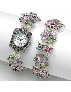 "Trendsetting two-piece set sparkles with Austrian crystal flowers on a matching watch and bracelet featuring simulated pearl, lucite and enamel accents. Quartz movement. Each is 7 1/2"" length with toggle closure. Enamel and antiqued silvertone metal. Watch movements are imported from Japan.  All watche's come with a warranty. sonsi.com"
