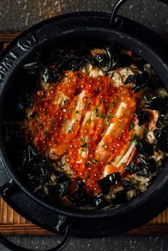 Hideki Hiwatashi's magnificent crab kamameshi recipe is packed with rice, king crab meat and sauce, topped with salmon roe for a vibrant garnish.