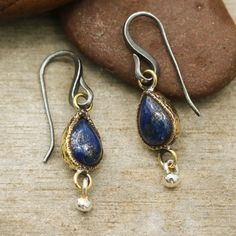 Teardrop cabochon lapis lazuli earrings in brass bezel setting and silver beads decorated below with oxidized sterling silver hooks