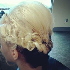 By Capitol School. Another unique bow braid updo by Erica B, a student at Capitol.   @BLOOM.COM