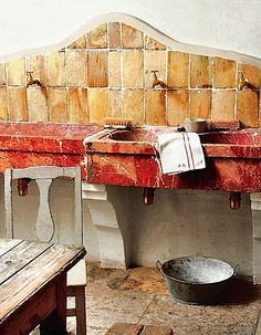 The old stone sinks in the summer kitchen, house in Provence, France.