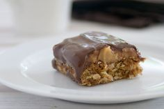 Ingredients 150g butter 2 tablespoons golden syrup 3/4 cup brown sugar 3/4 cup coconut 1 1/2 cups rolled oats 3/4 cup flour 1 1/2 teaspoons baking powder 75 g butter 1/2 cup brown sugar 395g can sw…