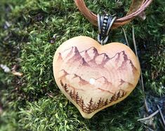 """How pretty is this pendant?! The back side reads: """"See those peaks, see those lines?"""" """"Where that ridge meets the skies?"""" """"They call me ...""""   Perfect for an outdoorsy person who loves hiking, or someone who has a spiritual connection with the mountains!"""