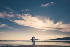Beach wedding photography, a romantic evening stroll in South Devon after wedding at Buckland Tout Saints. GRW Photography