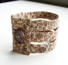 Fabric cuff bracelet in coffee and cream floral triple strand. $25.00, via Etsy.