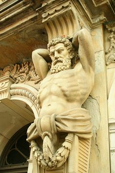 In architecture telamons are colossal male figures used as columns. These are also called atlas, atlantes or atlantids; they are the male versions of caryatids. Located at Wayne County Ohio Courthouse.