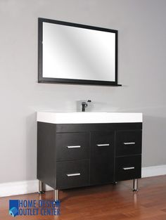 """AT-8041 Size: 39 """"W x 18 1/2""""D x 33 """"H. Mirror size: 39 1/2""""W x 26 1/2 """"H.This unique modern design bathroom vanity will give your bathroom a trendy and totally up-to-date appearance. Highest quality MDF/Wood veneer cabinet. Black color. White acrylic sink. Pop-up drain assembly. Self closing door & drawers.  Matching mirror. Side cabinet available. Vanity has opening for plumbing. Single hole faucet openings. No assembly required (finished cabinet)."""