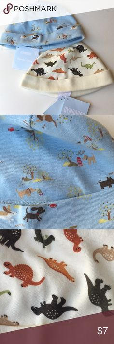 NWT Gymboree sleepy time hats set of 2 Adorable blue with dogs & cream with dinosaurs hats, set of 2 new with tags. Soft, lightweight, comforting 100% cotton. 6-12m *Save more, bundle with other items in my shop! Gymboree Accessories Hats