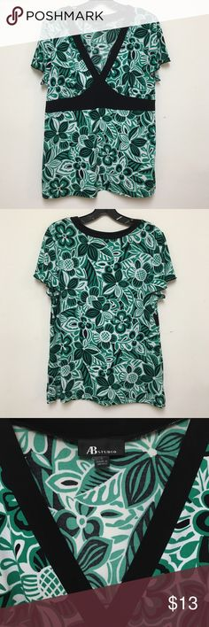 AB Studio A-Line Top - NWOT AB Studio gorgeous green, white, and black geometric printed top. Black lined V-neck accentuates bust. A-line flatters any figure. Top has ruffled sleeves giving it a feminine touch. NWOT - Size Large. AB Studio Tops Tunics