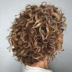 Curly Rounded Caramel Brown Bob Your naturally curly bob takes on a life of its own when the twists and turns are left to do their thing! It might not look like it, but these golden locks are still long enough to be pulled back into a ponytail or an updo. Curly Hair Cuts, Curly Hair Styles, Natural Hair Styles, Crazy Curly Hair, Short Stacked Haircuts, Short Curly Bob, Medium Curly Bob, Short Curls, Medium Bob Hairstyles