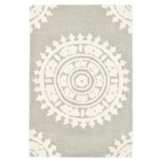 Hand-tufted New Zealand wool rug with an oversized medallion motif.  Product: RugConstruction Material: New Zealand woolColor: Light grey and ivoryFeatures: Handmade Note: Please be aware that actual colors may vary from those shown on your screen. Accent rugs may also not show the entire pattern that the corresponding area rugs have.
