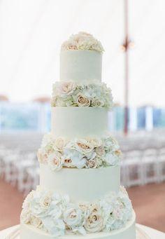 Traditional wedding cake idea - Four-tier white fondant-frosted wedding cake with white, ivory, and cream flowers {shoreshotz photography}