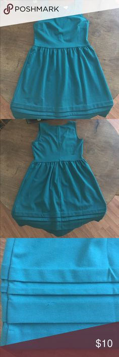 Merona teal dress size Med Adorable sleeveless dress with zip up back. Cute pleat details at the hem. Slight deodorant in the underarms, minimally noticeable, likely to come out in the wash. 1 pulled thread at the bottom as pictured. Merona Dresses Midi
