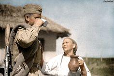 Soviet soldier gets a drink / wwii