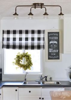 Kitchen Lighting Ideas A budget friendly, black and white country cottage farmhouse kitchen - Smart, stylish, and space-saving ideas for decorating the heart of the home. Farmhouse Kitchen Lighting, Kitchen Lighting Fixtures, Rustic Kitchen, Kitchen White, Kitchen Country, Kitchen Ceiling Lights, Vintage Kitchen, Track Lighting In Kitchen, Lights For Kitchen