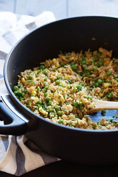 The Best 10 Minute Veggie Fried Rice - Brown rice, frozen corn and peas, creamy eggs, fresh herbs, garlic, and ginger. 300 calories.