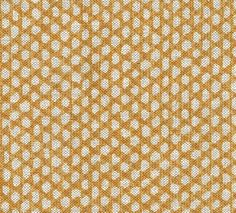 Wicker Linen Fabric A printed fabric with subtle shades of gold and orange in a wicker work design, printed on a natural linen.