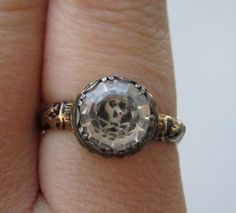 Very early ca. 1680 - 1700 mourning ring with skull.  Jewelers often made these rings for sale and then inscribed them.  Often, the deceased would have included the rings in the will .....bequeathed to close relatives and friends.