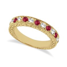This semi eternity vintage style ruby and diamond wedding ring features 7 brilliant cut VS2 G-H round diamonds alternating with 6 colored gemstones.<P>The 14kt Yellow Gold Ruby ring has milgrain edges and a filigree design for the ultimate designer's touch.<P>Wear it as a wedding band, as an anniversary ring, or as a right hand fashion ring.<P>The heirloom ruby wedding band measures 4.20mm tapering off to 3.95mm and is set in a pave setting.; $1491