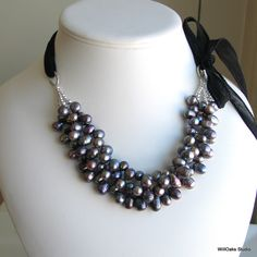 Dark Peacock Pearl Bib, Statement Bib Multistrand Pearls on Black Silk Ribbon, Fashion Pearls Necklace, Deluxe Gift for Her. $63.00, via Etsy.