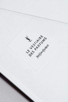YSL Le Vestiaire des Perfums fragrance logo. Packaging detail. Logotype consulting commissioned by Yves Saint Laurent Beauté for the 'Le Vestiaire des Parfums', a collection of five exclusive fragrances each interpreting a centrepiece of the emblematic Yves Saint Laurent wardrobe. Packaging and bottle design by ©YSL Parfums. ©Yves Saint Laurent Parfums.