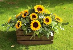 The cheery and bright look of sunflowers will be a lovely reminder of happy days. Double ended spray of sunflowers and seasonal foliage