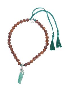 Wood and silk necklace decorated with 22-carat Colombian emeralds