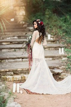 Long sleeve lace wedding dress with open back   Image by Holly Kringer Photography