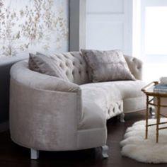 Light grey circular sofa