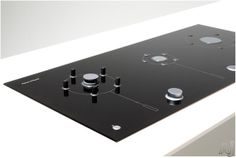 """Fisher & Paykel 36"""" 3 gas burner cooktop: Retractable burner heads, pan support and control knobs. Flush design. Ceramic glass surface $2300"""