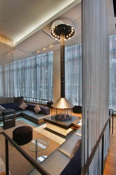 Decorative firescreens and wire mesh curtains create a modern lounge at The Benson Hotel.