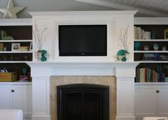Love the tv into the mantle and the bookcases on either side...plus bonus storage space below the bookcases.