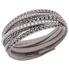 Slake Light Bracelet: Gradation of dark and clear crystal on a light gray Alcantara fabric.