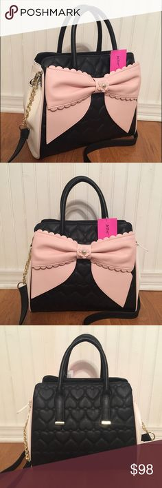 """Betsey Johnson Tote Shopper Black Bone Blush Bow Gorgeous Betsey Johnson Purse 3 Entry Shopper - One Zipper Entry / Two Snap Entries Black heart-shaped quilt pattern on front and back. Large blush pink bow on front with pearl detail. Cream/bone colored side panels with blush pink piping. Black Handles Black Shoulder Strap with Gold Chain  *Please note that this item is marked """"no returns"""". If you have any questions or concerns, please contact me prior to purchase.* Betsey Johnson Bags Totes"""