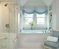 The Blue Hues Of This Window Treatment Work Perfectly In White Bathroom Other Accents Create A Soothing Timeless Look