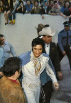 Elvis in Houston, TX, surrounded by bodyguards and security.