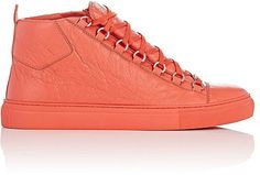 """$449 - Balenciaga Men's Arena Leather Sneakers - Styled with a tonal sole, Balenciaga's Arena Leather high-top sneakers are crafted of orange wrinkled lambskin. 1.25""""/30mm midsole (approximately). Rounded toe. Wide padded gusseted tongue. Padded collar. Pull tab at topline. Orange midsole. Orange flat laces. Silvertone hardware. Lace-up style. Lined with smooth leather. Rubber sole. Available in Orange. Made in Spain.;LEATHER"""