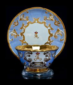 Antique Russian Imperial Porcelain Cup And Saucer from the Banquet service of the Peterhof palace near St Petersburg both pieces are painted with a gold cipher of Tsarevich Alexander made at the Imperial porcelain factory during the reign of Tsar Alexander III