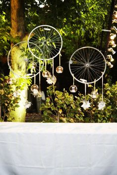 Bike rims with hanging tea lights / Party decorations, Backdrop // ROOT 75 flowers & home - coronado, ca
